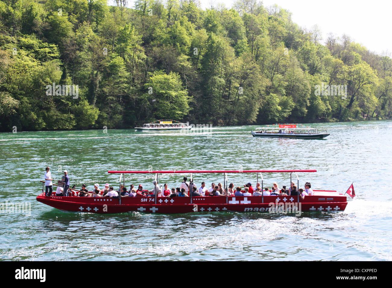 Red boat in Rhine river in Switzerland Stock Photo