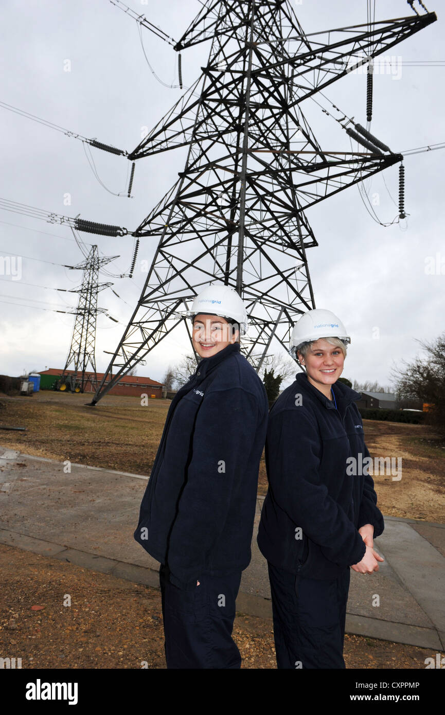 Portrait of two young female apprentices working for  the National Grid, training to be an overhead cable technician Stock Photo