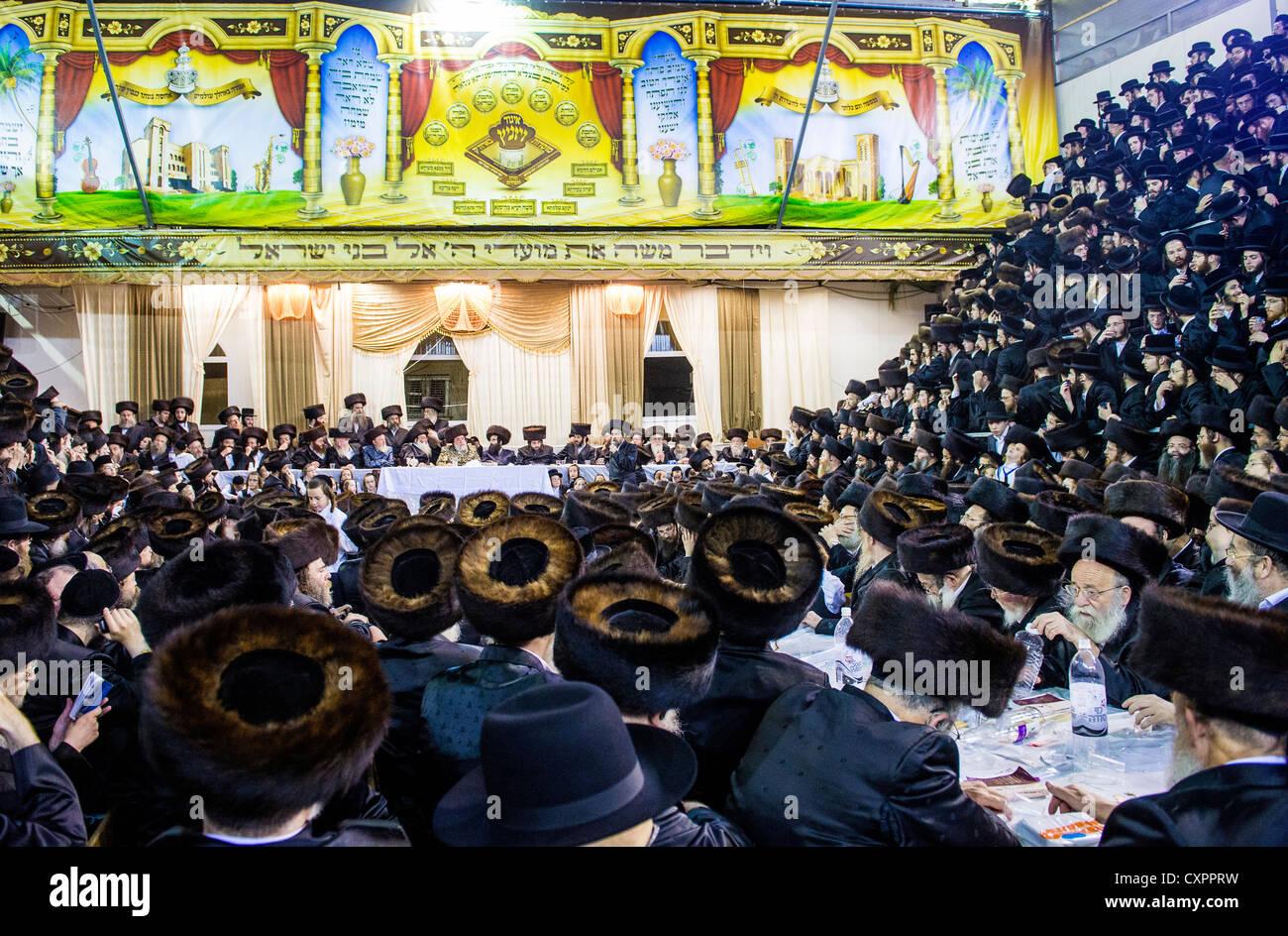 Orthodox Jews from the Hasidic dynasty Vizhnitz celebrates Simchat beit Hashoeivah in Bnei Brak Israel - Stock Image