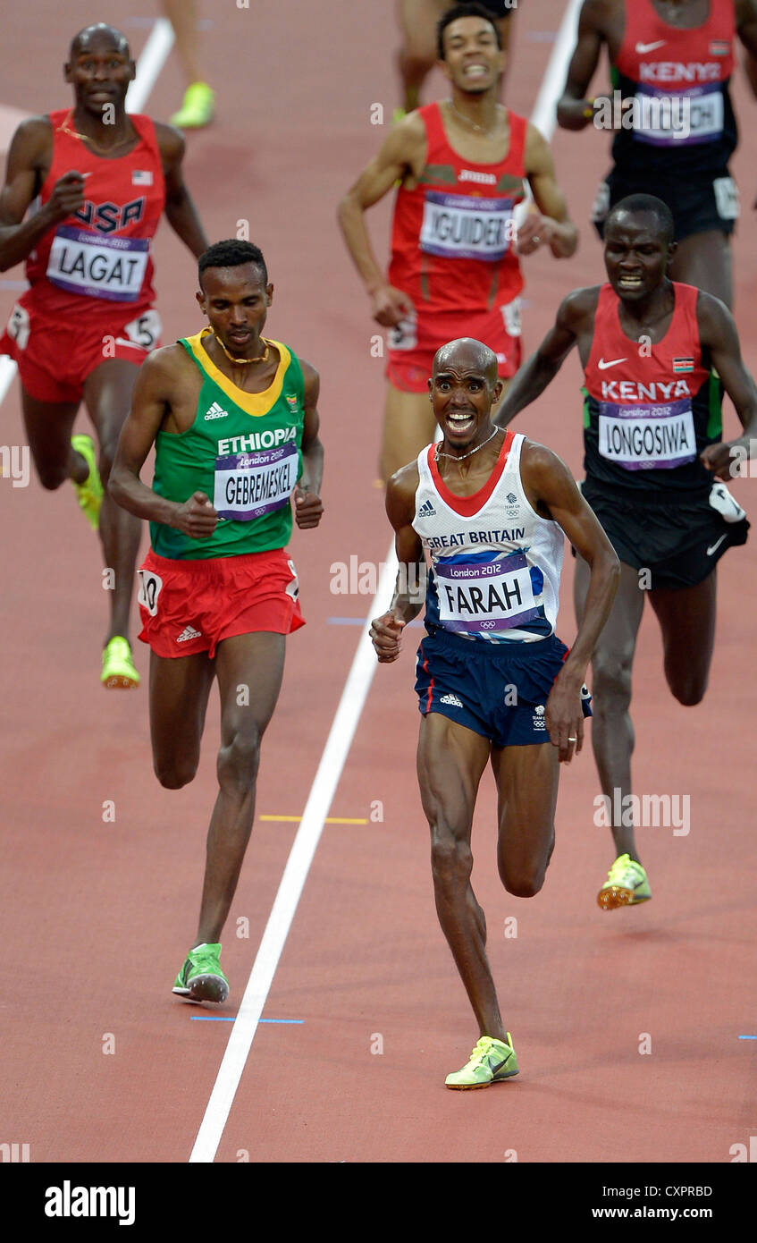 Britain's Mohamed Farah charges for the line. - Stock Image