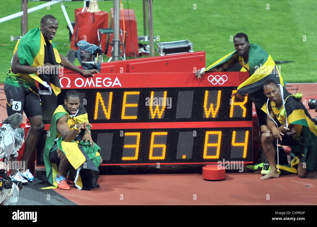 The Jamaican 4x100m athletes with the sign announcing their new World Record. - Stock Image