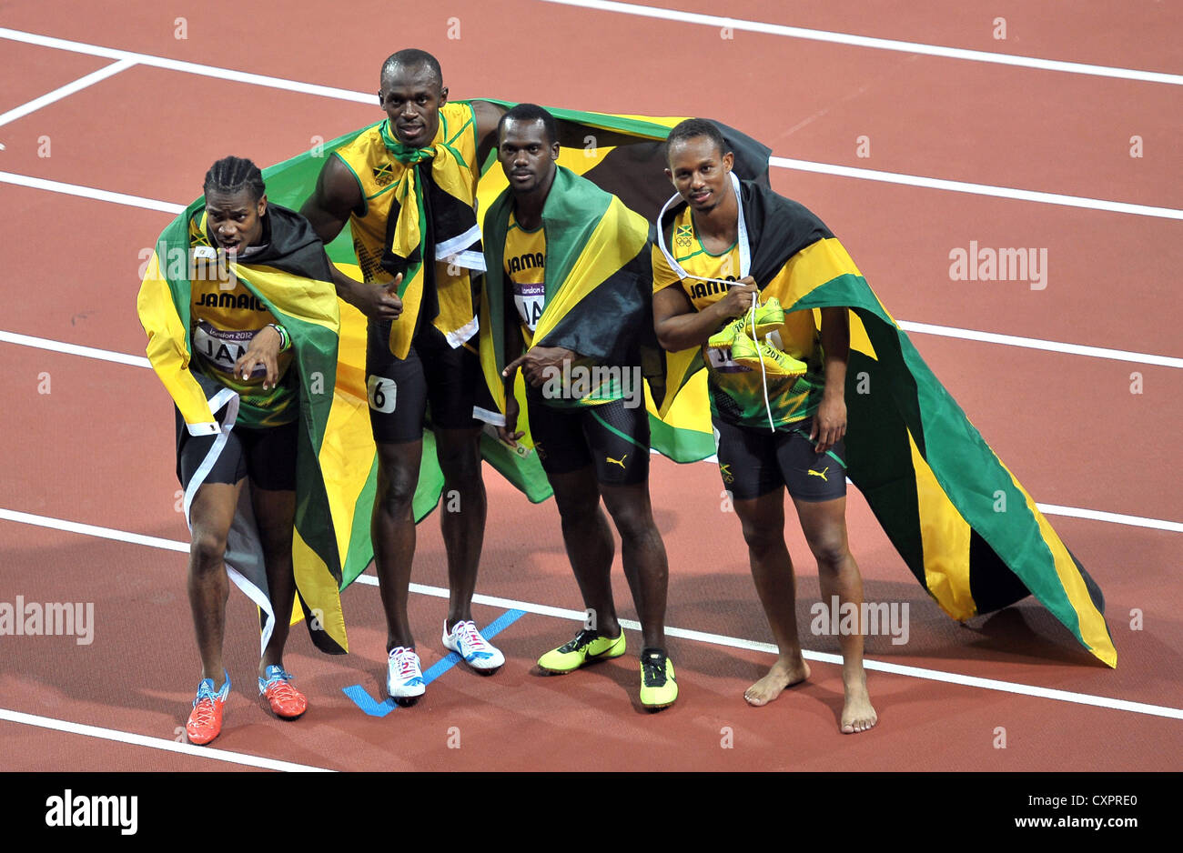 The Jamaican 4x100m team. celebrate after their world record in the 4x100m final - Stock Image