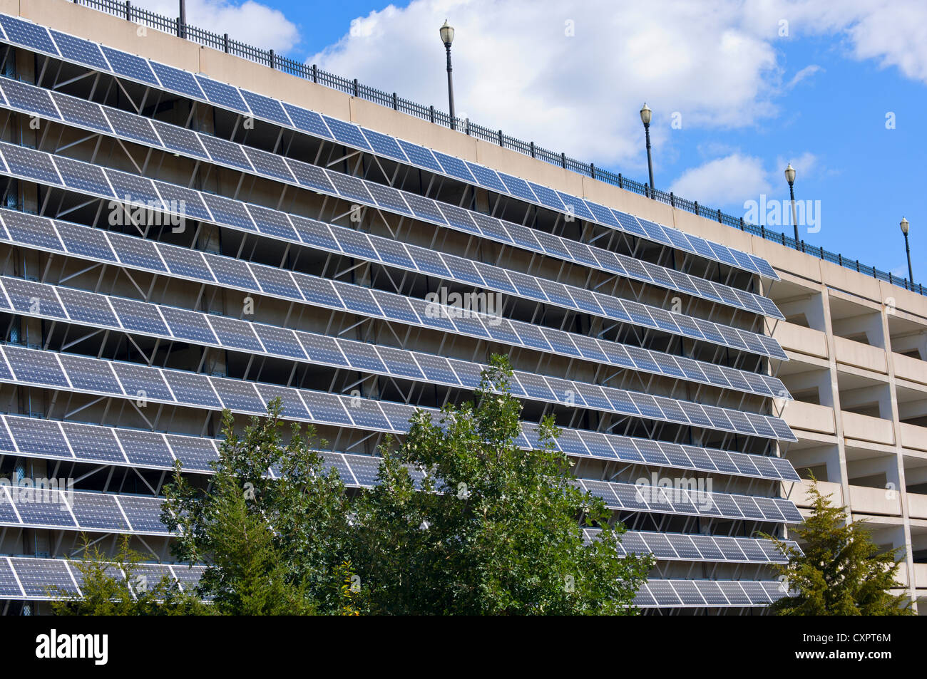 Solar Panels Mounted On Exterior Wall Of Parking Garage In