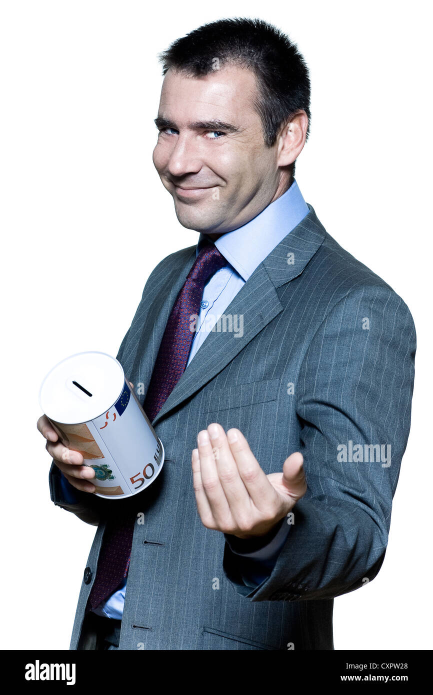 portrait on isolated white background of a smiling  businessman holding a moneybox begging for money - Stock Image