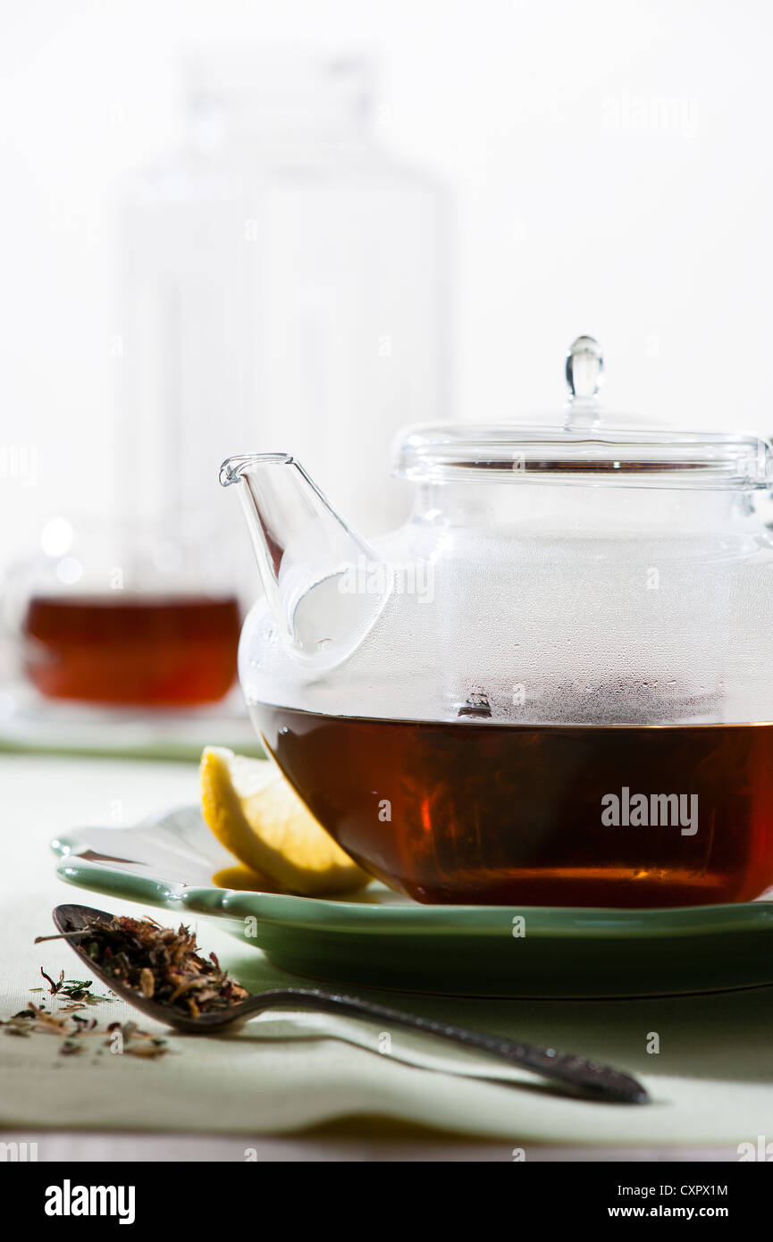 TEA IN TEA POT - Stock Image