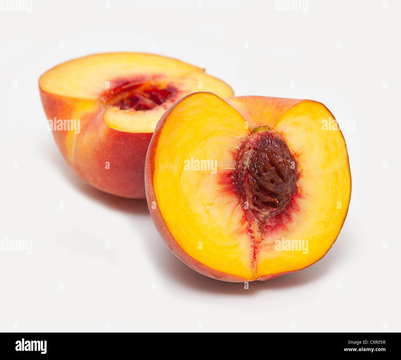 Peach cut in half - Stock Image