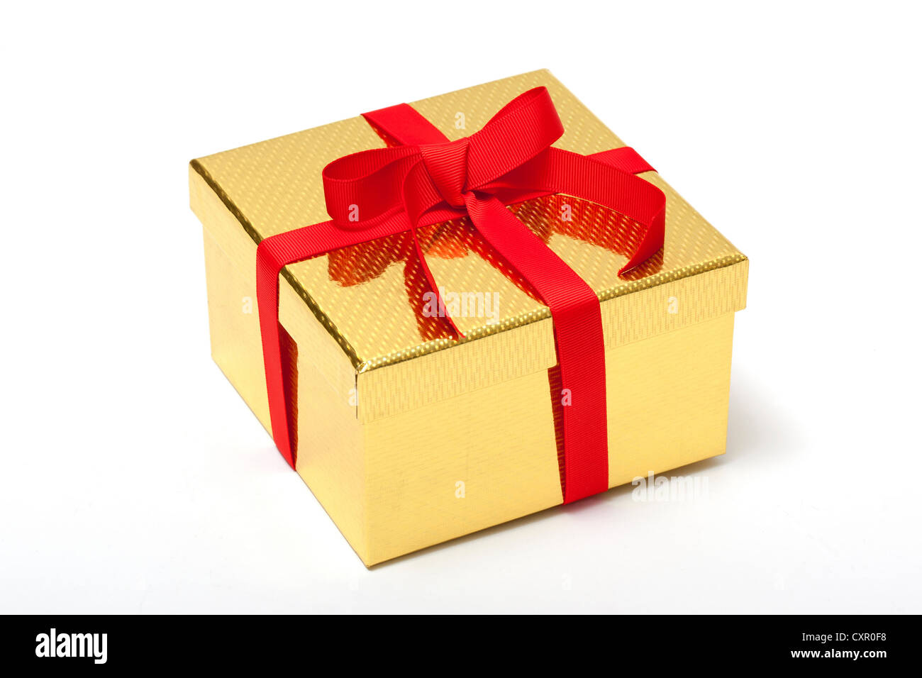 Golden gift box with red ribbon - Stock Image