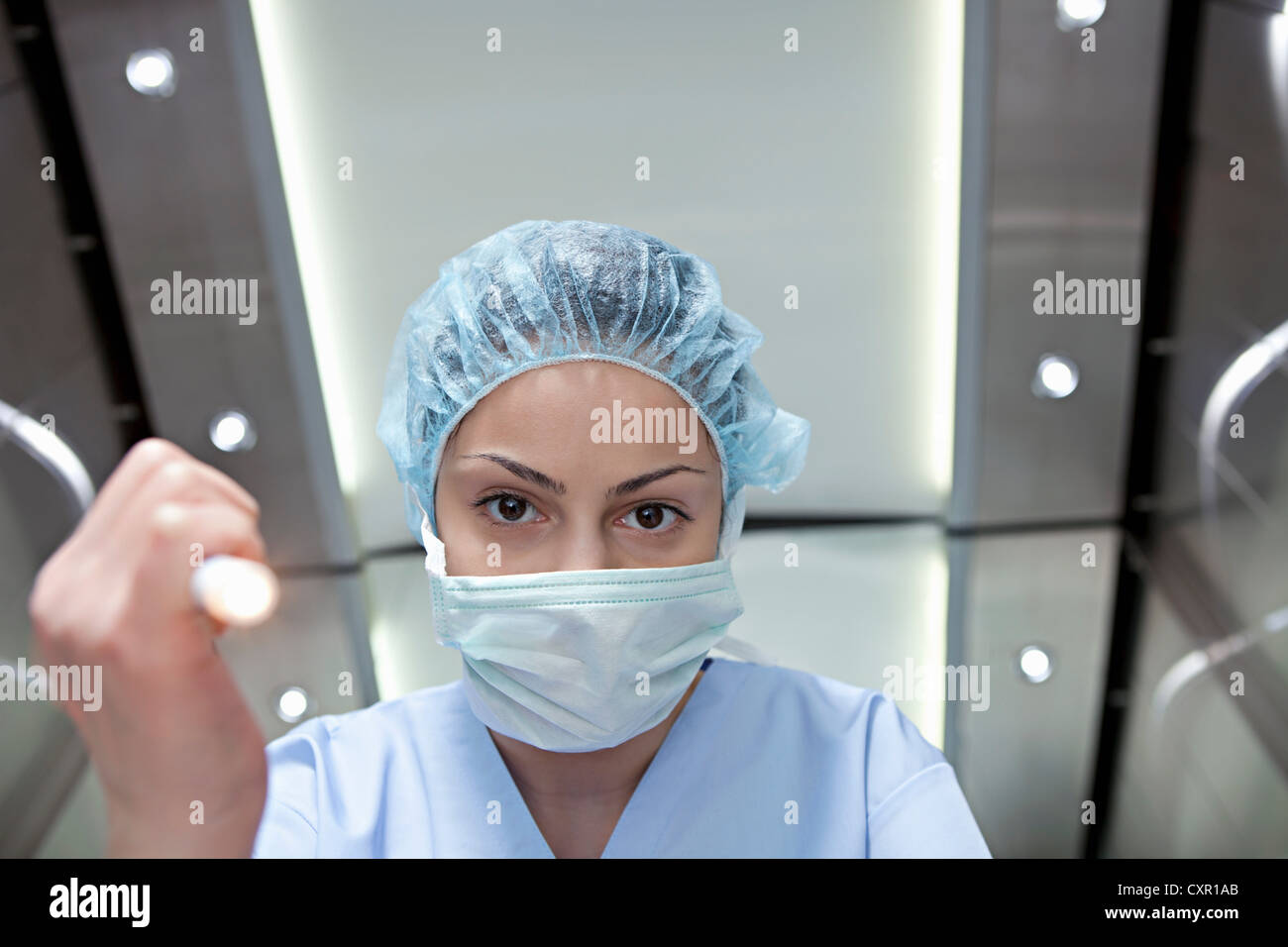 Surgeon shining torch, personal perspective - Stock Image