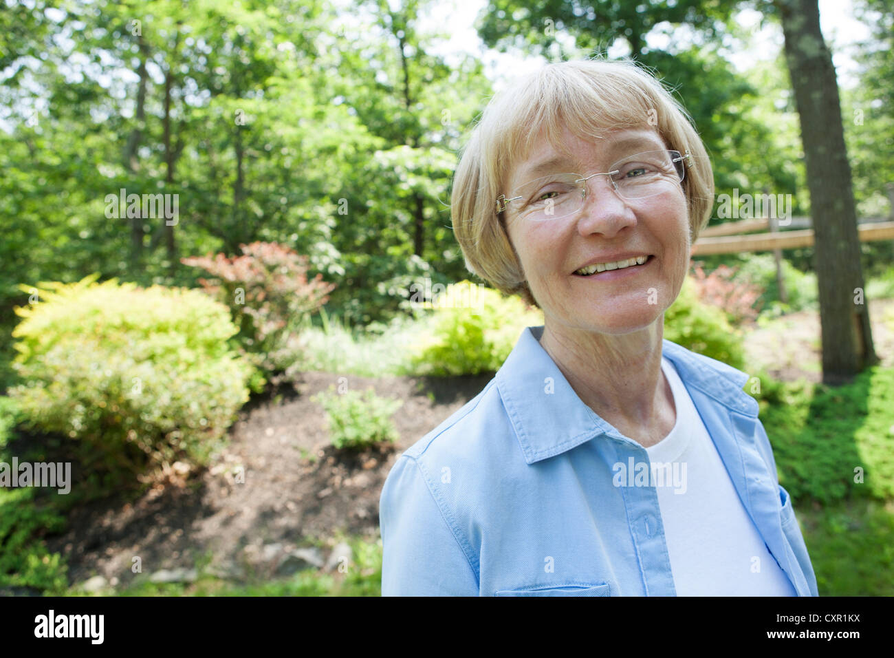 Woman in garden - Stock Image