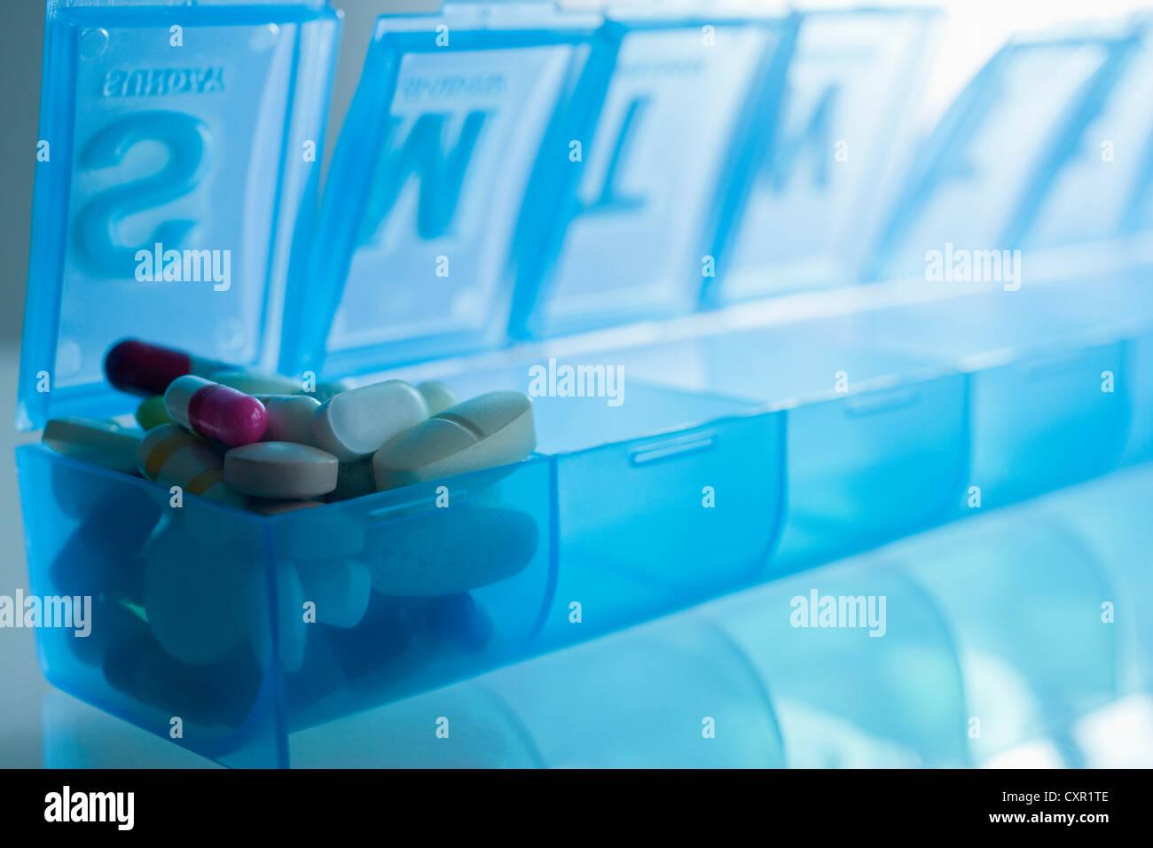 Pills in pillbox - Stock Image