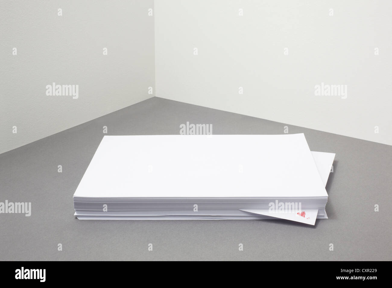 Stack of blank paper with heart shape on one piece Stock Photo