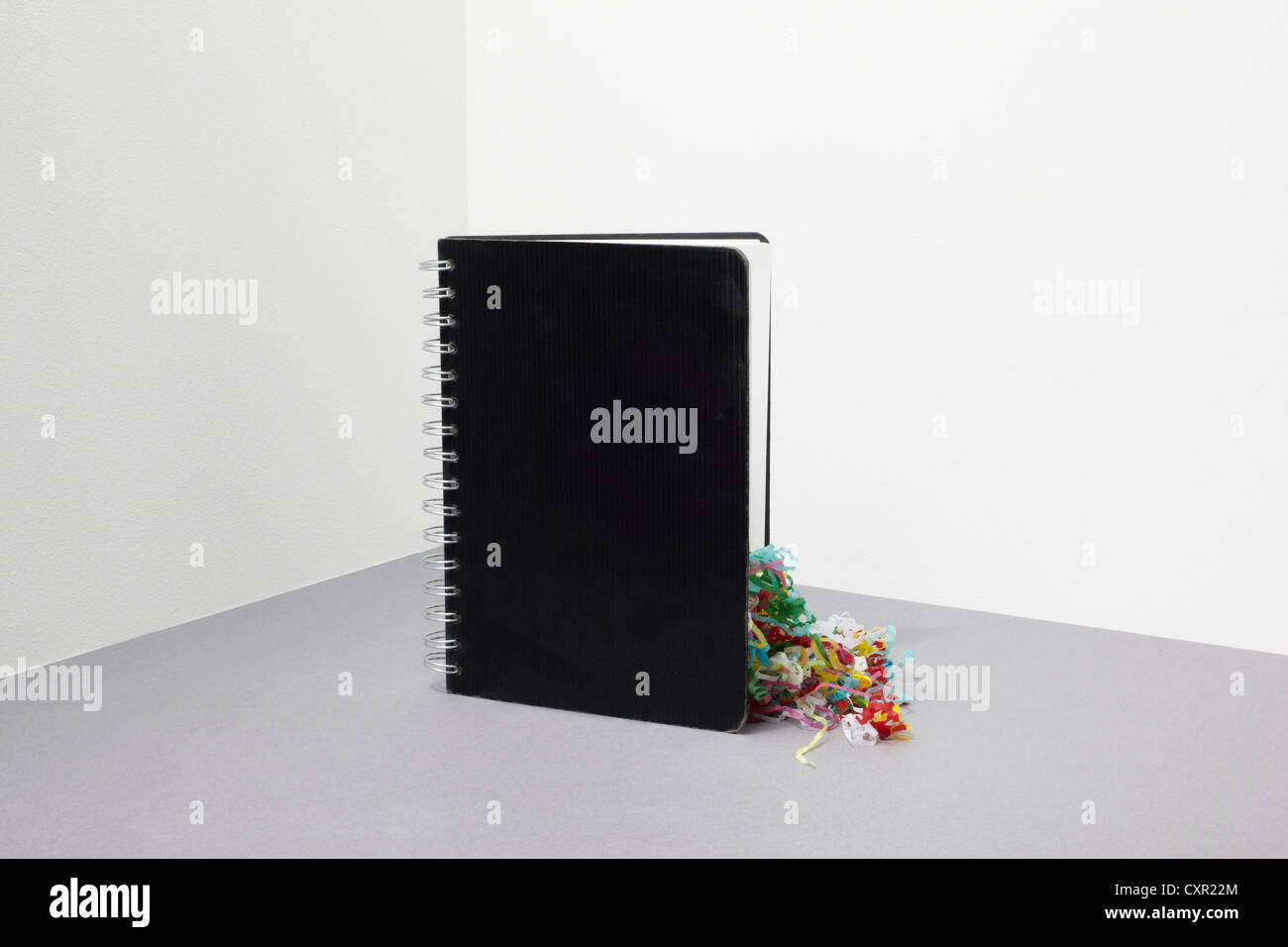 Notebook with streamers inside - Stock Image
