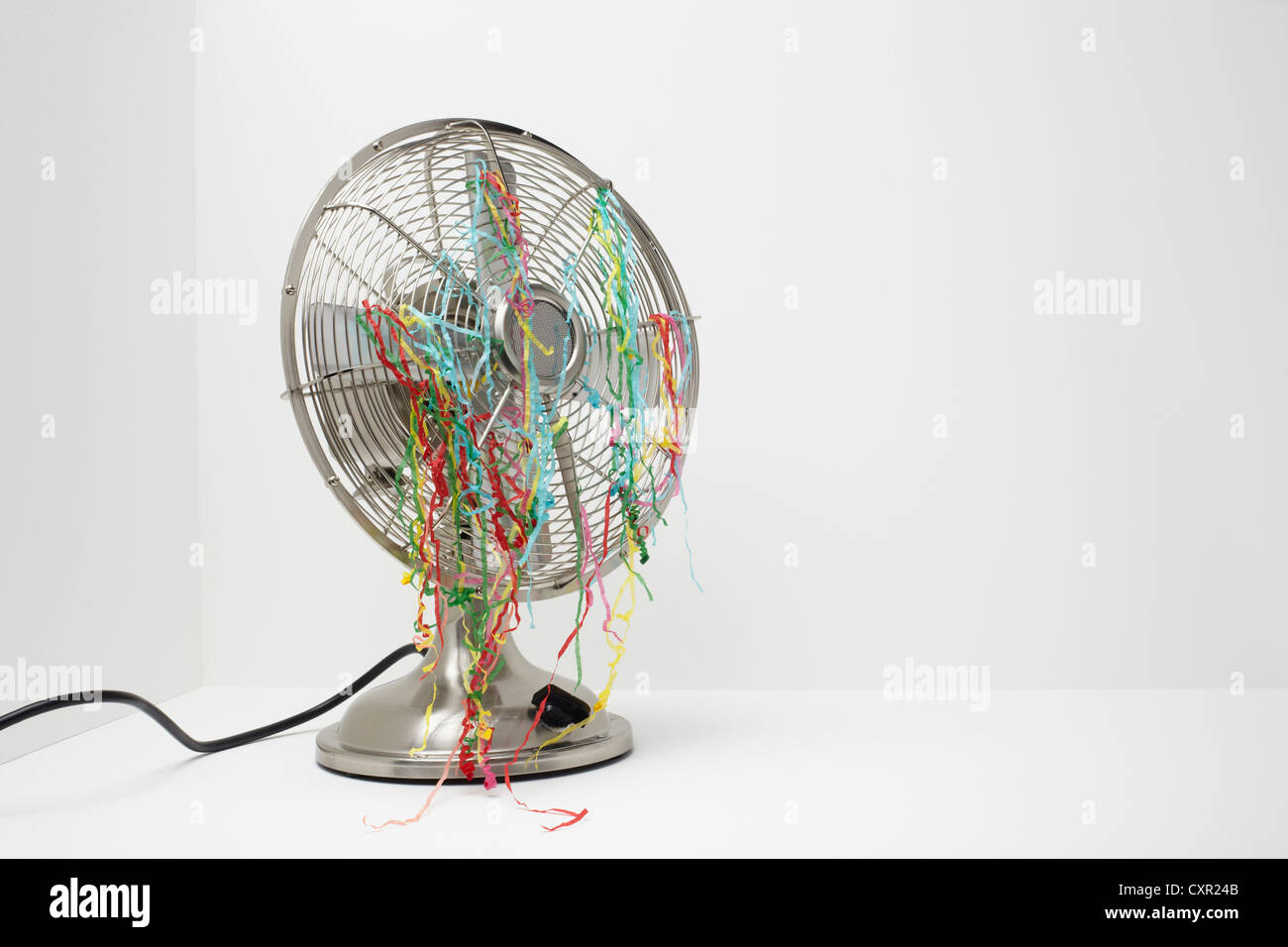 Electric fan with streamers - Stock Image