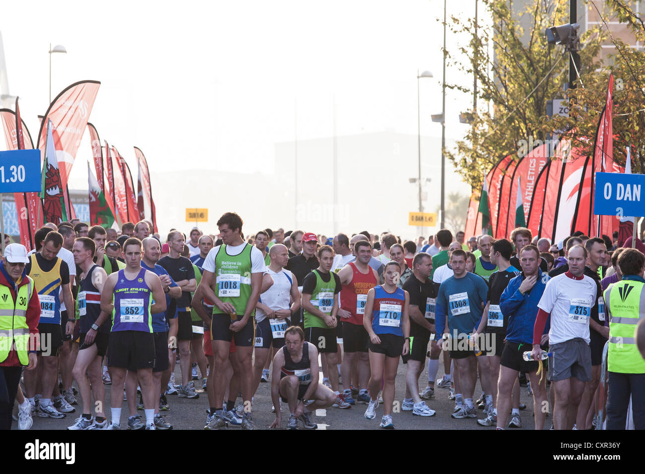 The elite runners wait at the start line for the beginning of the Cardiff Half marathon 2011. - Stock Image
