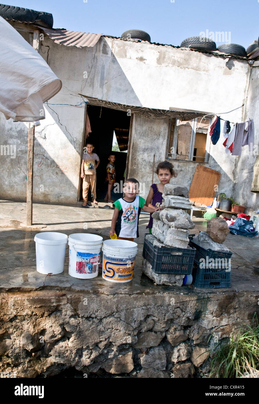 Syrian refugee children from Homs shelter in a home across the border in the northern Lebanese region of Wadi Khaled. - Stock Image