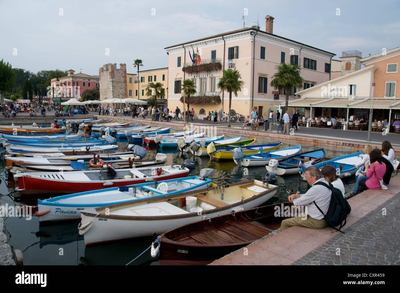 A fleet of local fishing boats in Bardolino, Lake Garda,Veneto Region,Italy Stock Photo