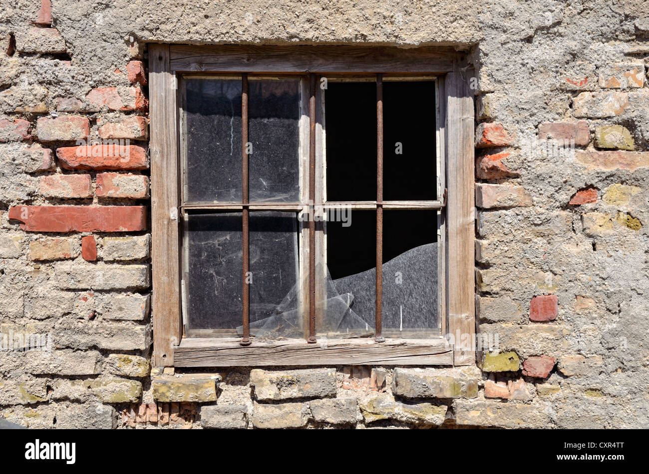 Stable with a barred broken window, brickwork made from Reichsformat or German format bricks, Miesbach, Upper Bavaria, - Stock Image