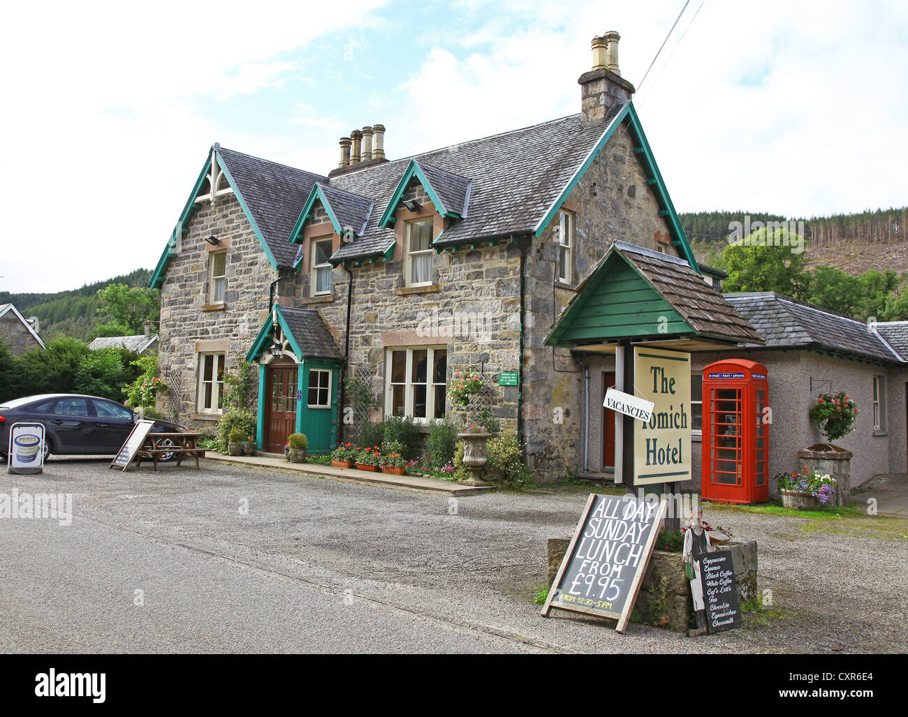 The Tomich Hotel in a Victorian model conservation village Inverness-shire Scottish Highlands Scotland - Stock Image