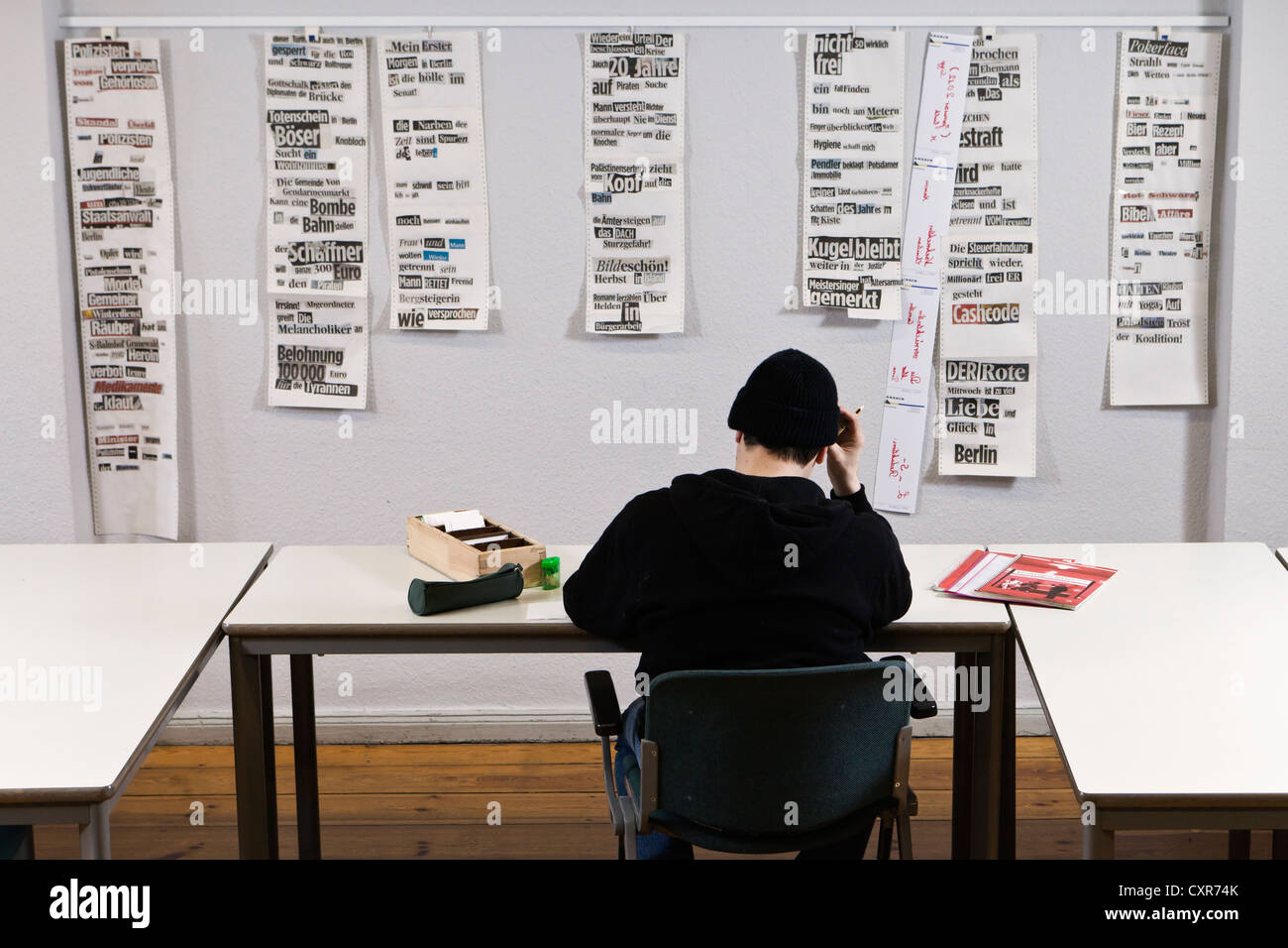 Illiterate doing writing exercises at Lesen und Schreiben, German for Read and Write, a learning facility in Neukoelln, - Stock Image