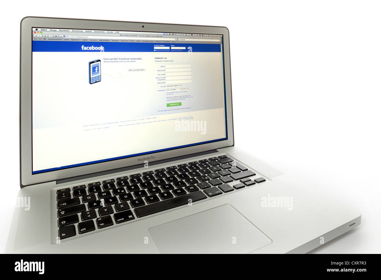 Portuguese language version of Facebook, social networking website displayed on the screen of an Apple MacBook Pro Stock Photo