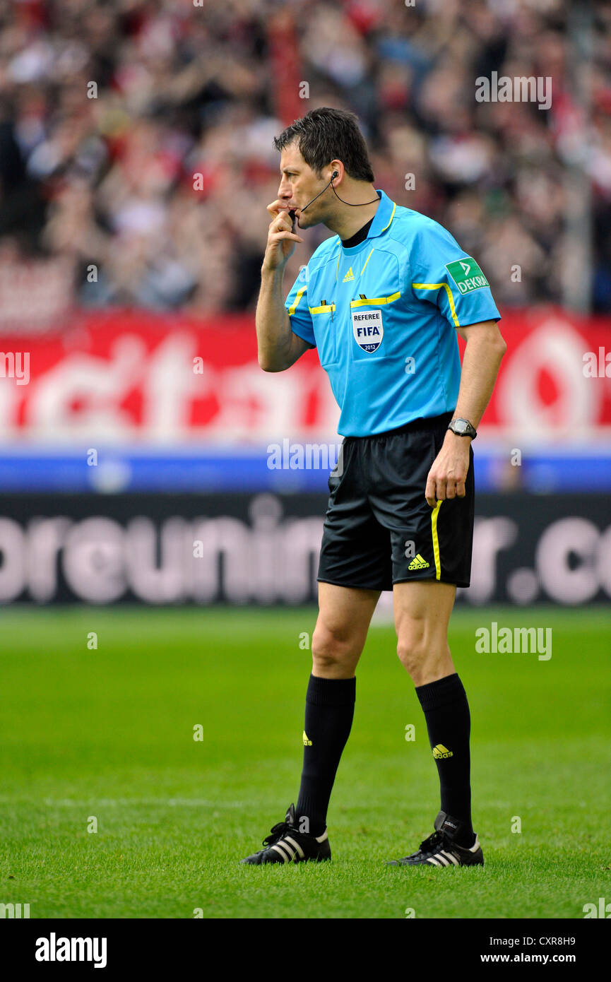 Referee Wolfgang Stark showing foul play, awarding a free kick, Mercedes-Benz Arena, Stuttgart, Baden-Wuerttemberg - Stock Image