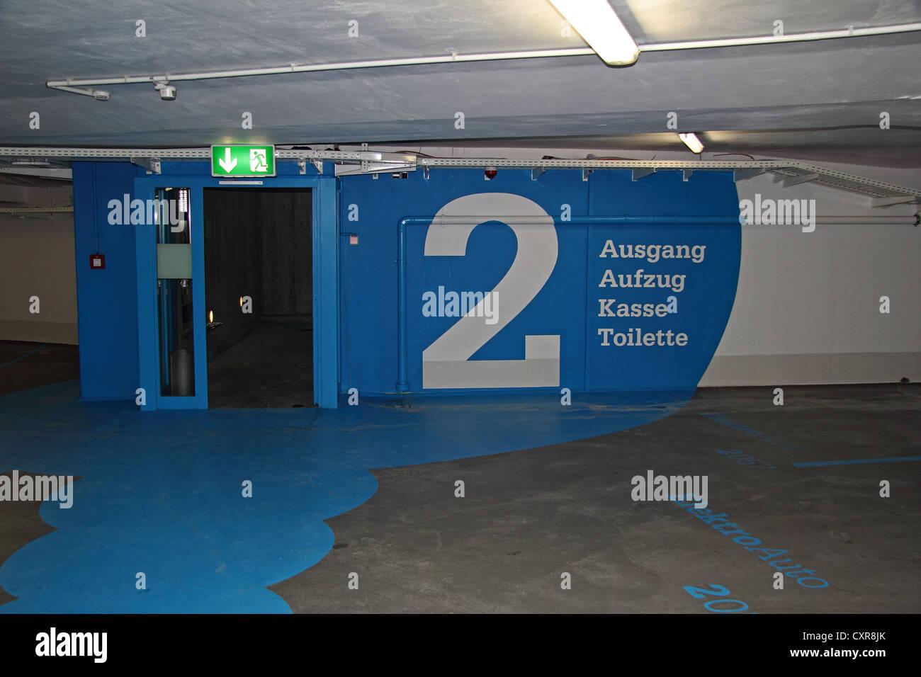 'Ausgang, Aufzug, Kasse, Toilette', German for exit, lift, pay desk, toilets', signs at Viemarktplatz - Stock Image