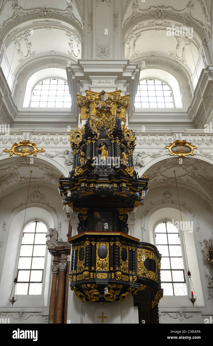 Pulpit with sounding board and a statue of John the Baptist, old cathedral, Ignatiuskirche church, cultural monument - Stock Image