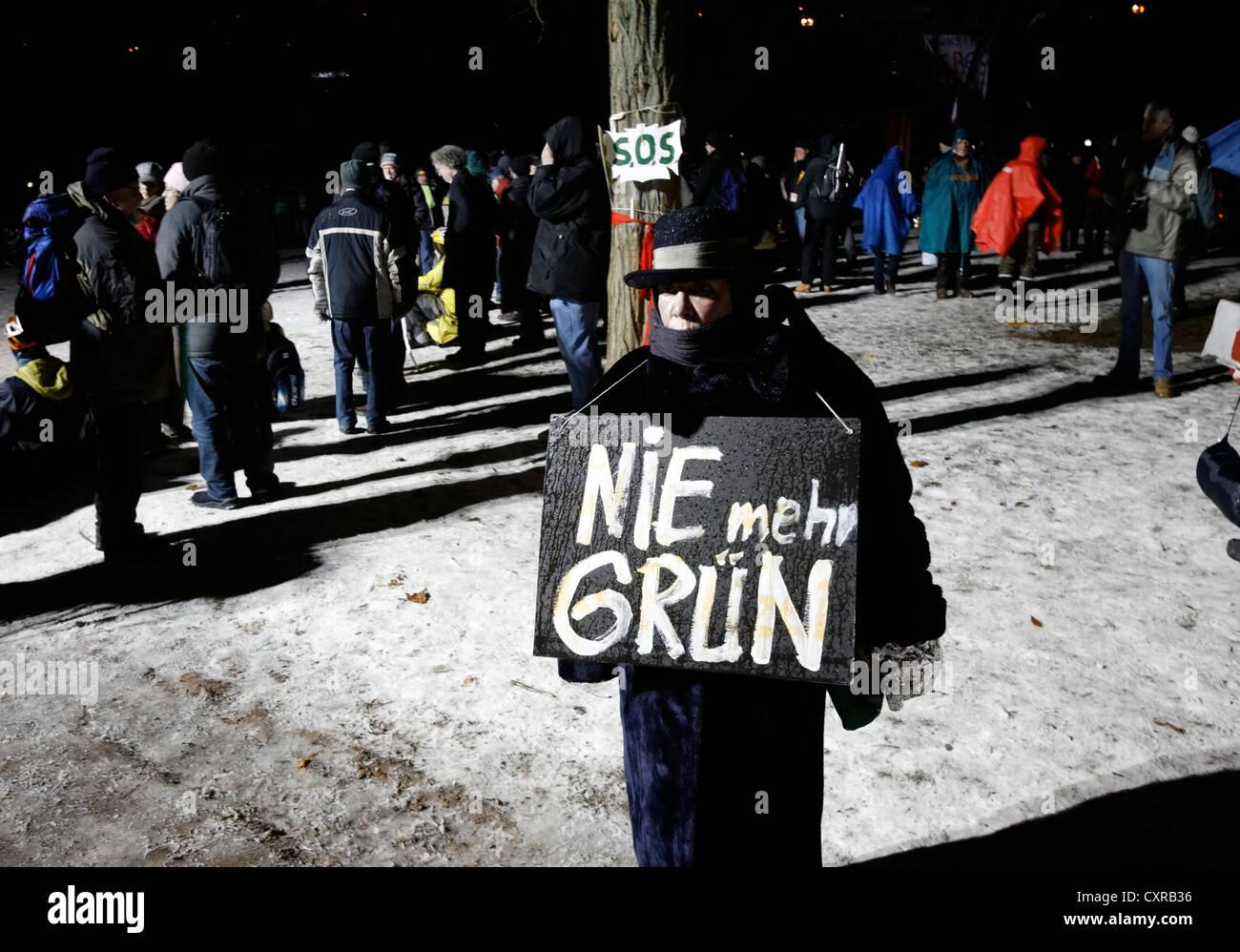 Demonstrator against Stuttgart 21 holding a sign, Nie mehr Gruen, German for Greens never again, in - Stock Image