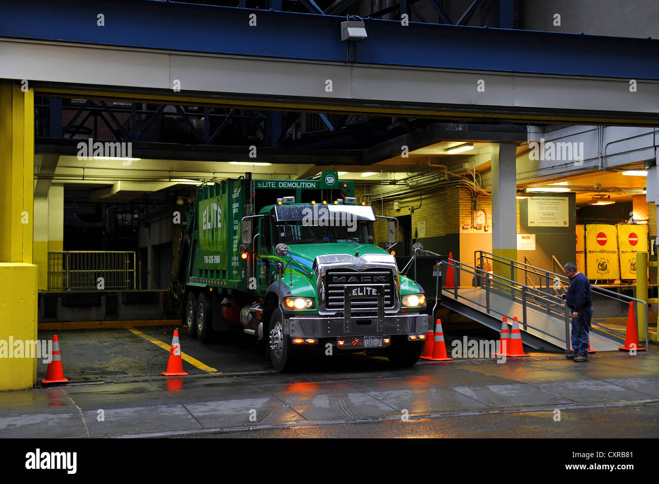 Garbage truck, Elite Demolition, Midtown Manhattan, New York City, New York, USA, United States of America, North - Stock Image