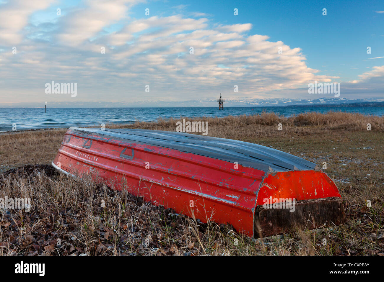 Red lifeboat lying upside down on the shore of Lake Constance near Konstanz, Constance, Baden-Wuerttemberg, PublicGround - Stock Image