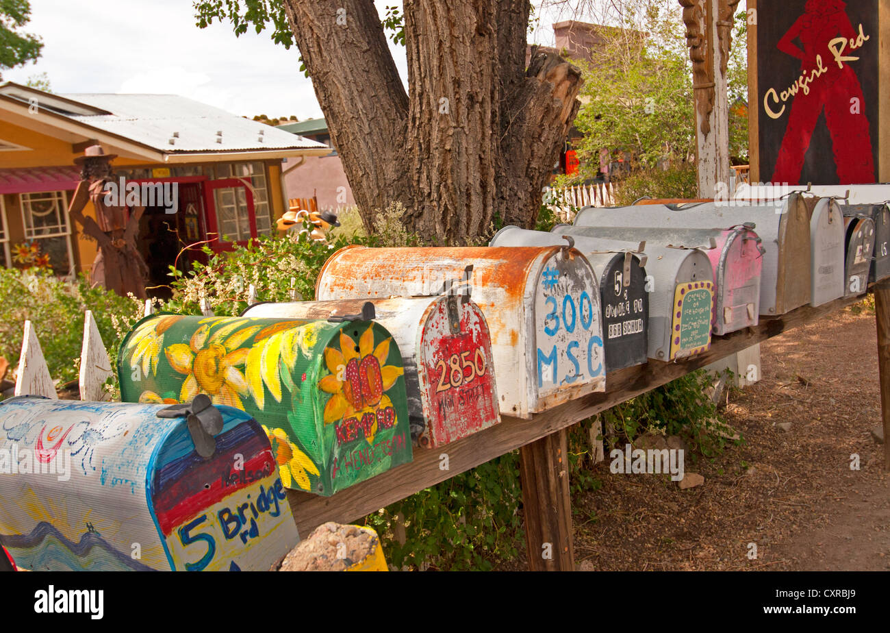 A row of colorful mailboxes in Madrid, New Mexico, along the Turquoise Trail Stock Photo