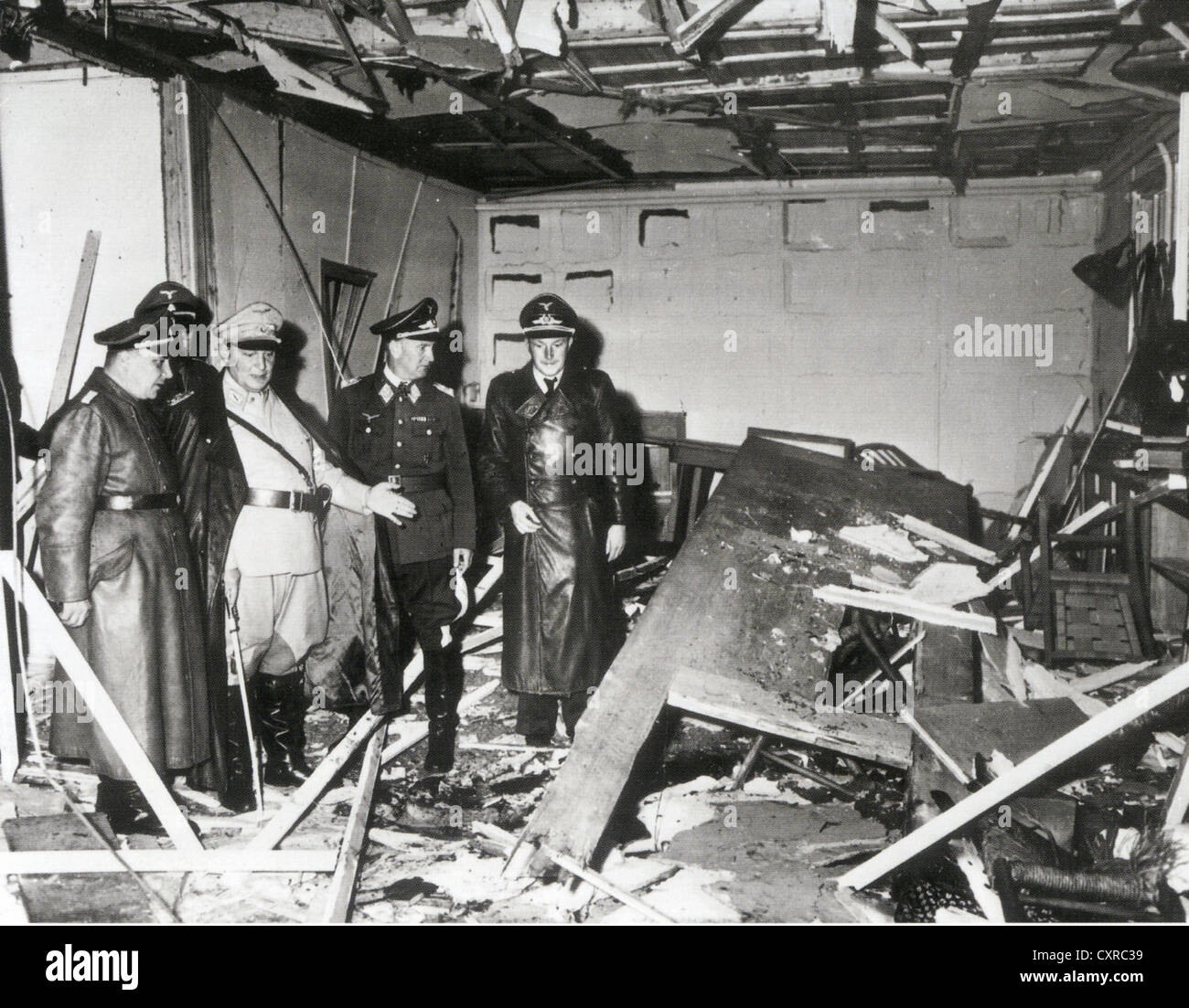 HERMAN GORING second from left shows Martin Bormann at left  damage in Hitler's HQ after assassination attempt - Stock Image
