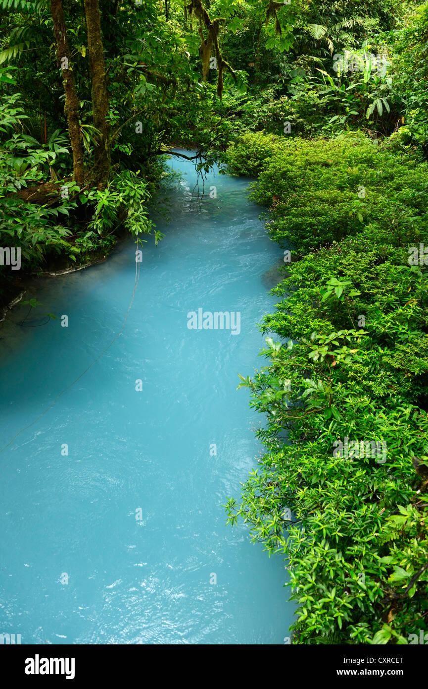 River Rio Celeste, coloured light blue by minerals, Tenorio Volcano National Park, Costa Rica, Central America - Stock Image