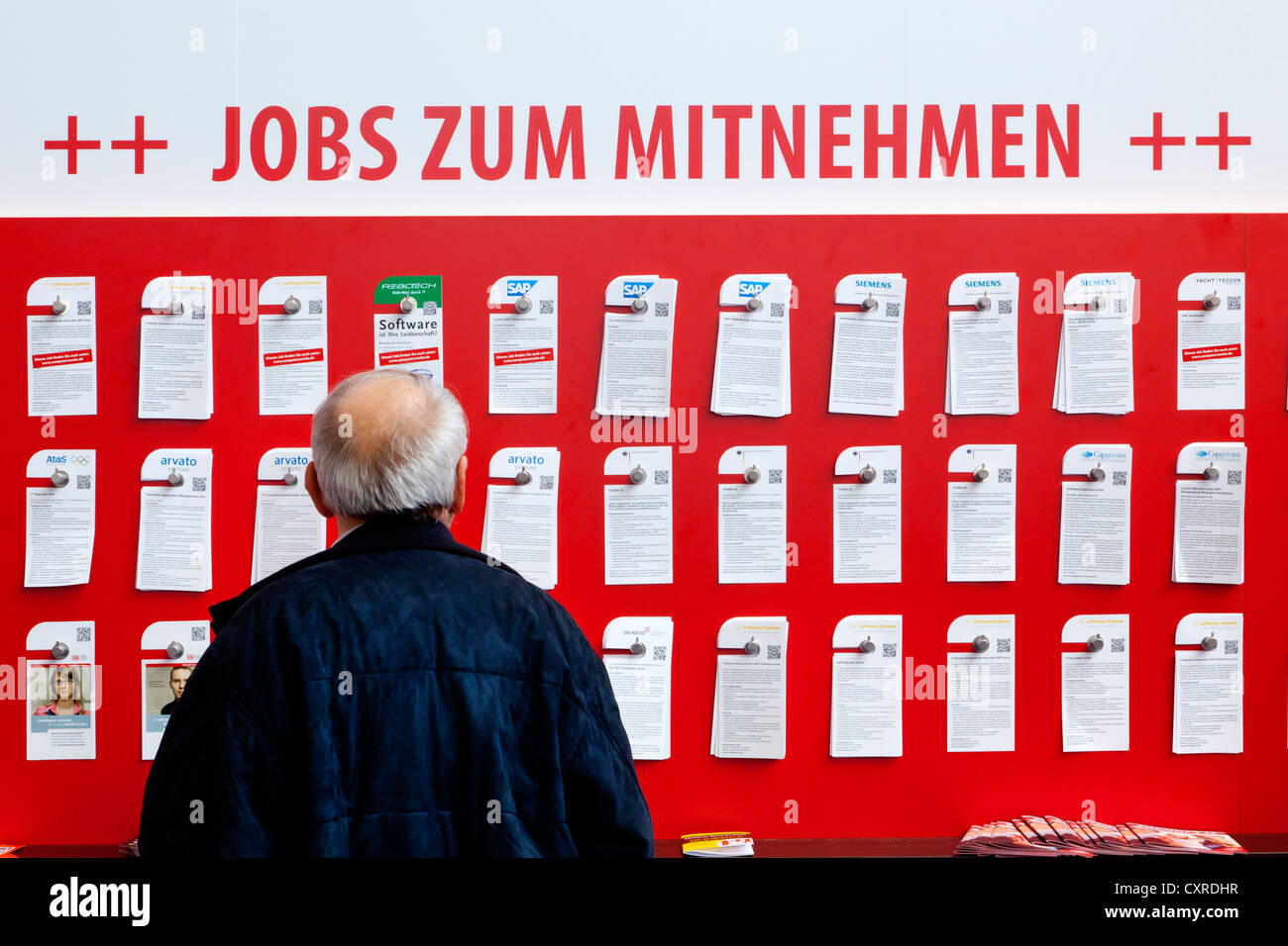 Exhibition stand of the employment office, lettering 'Jobs zum Mitnehmen', German for 'Pick up a job - Stock Image