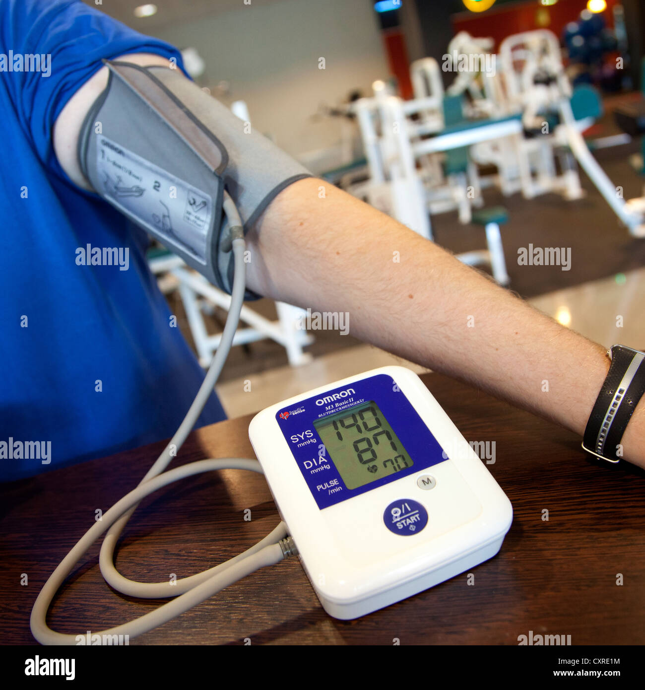 Heart rate monitor, blood pressure measurement, prior to a workout at the fitness centre, Regensburg, Bavaria, Germany, - Stock Image