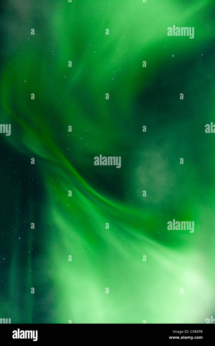 Swirling green northern polar lights, burst, Aurora borealis, near Whitehorse, Yukon Territory, Canada - Stock Image