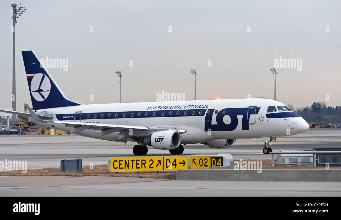 LOT Embraer 170-200LR airplane taxiing to the runway at Munich Airport, Bavaria, Germany, Europe - Stock Image