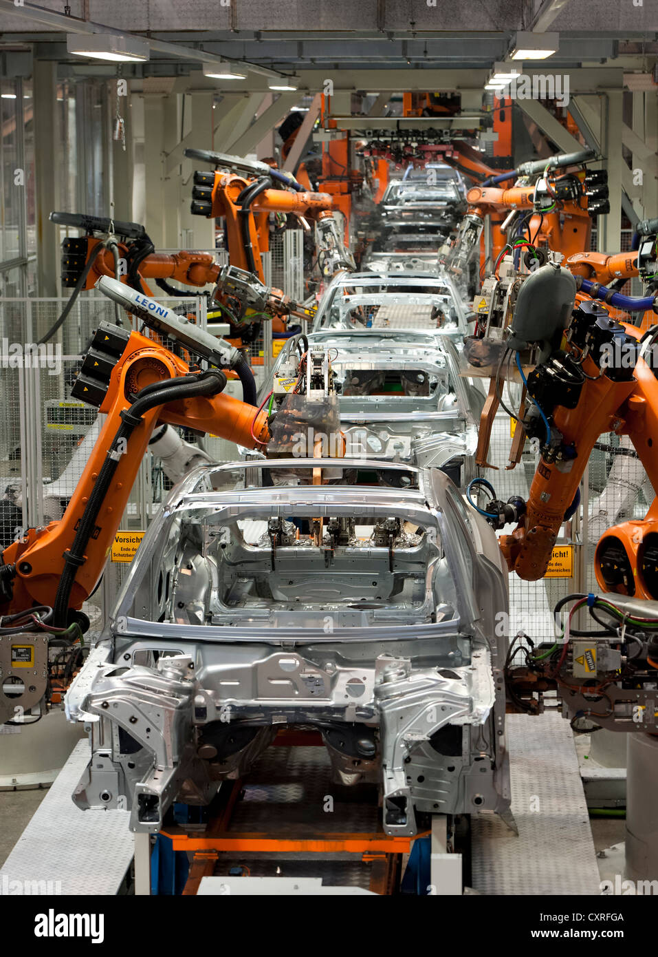 Industrial robots putting out car bodies on assembly line 2, Audi A4 Sedan, A4 Avant, A5 Coupe, A5 Sportback and - Stock Image
