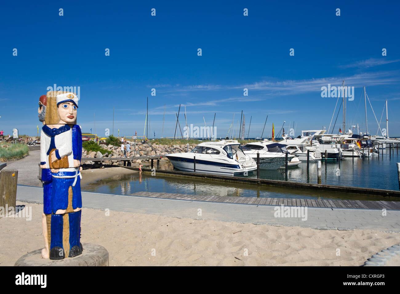 Sailor figure, marina and beach, Groemitz, Baltic Sea, Schleswig-Holstein, Germany, Europe - Stock Image