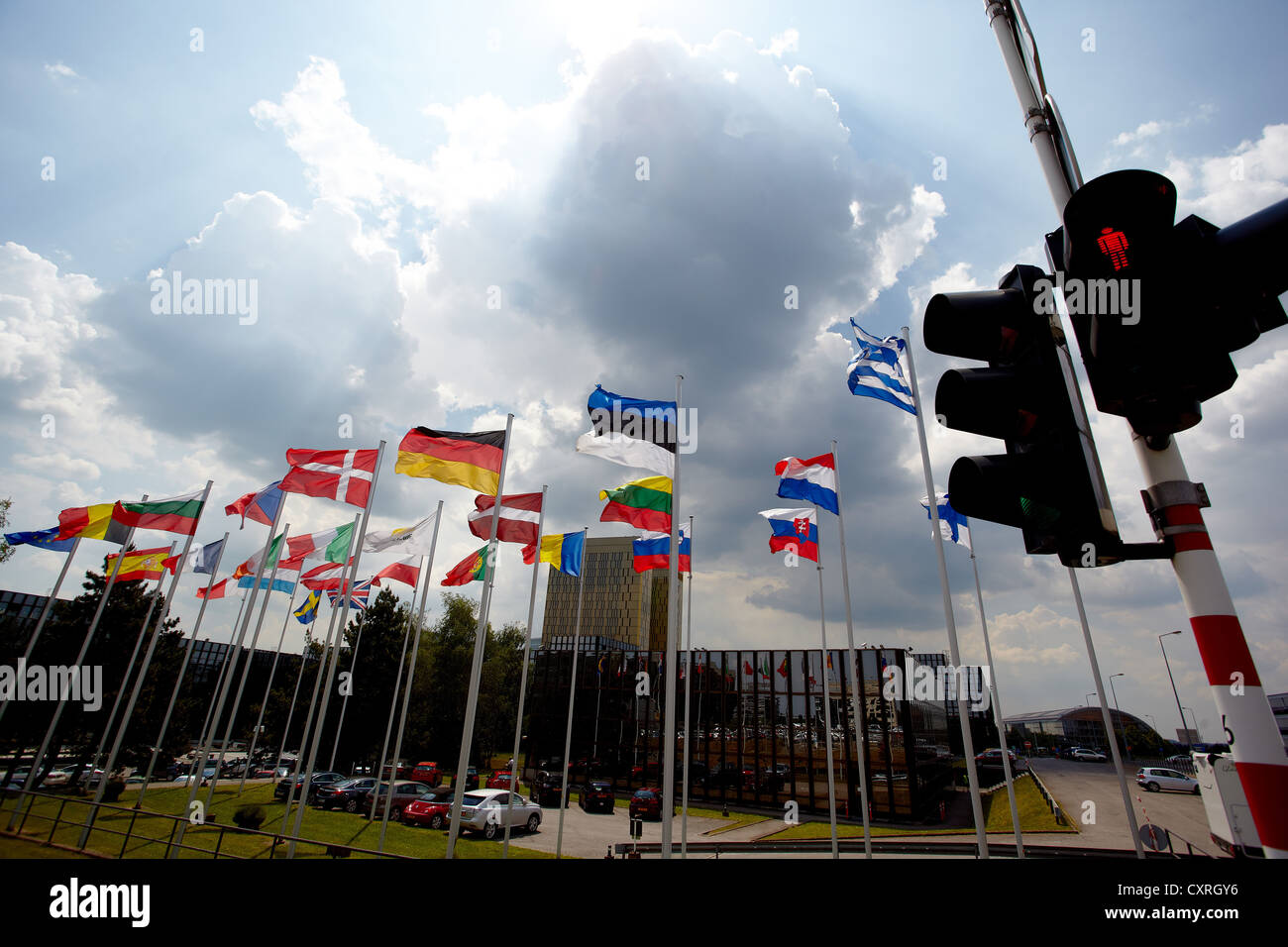 Red traffic lights in front of the national flags of the member states of the European Union, building of the European Stock Photo