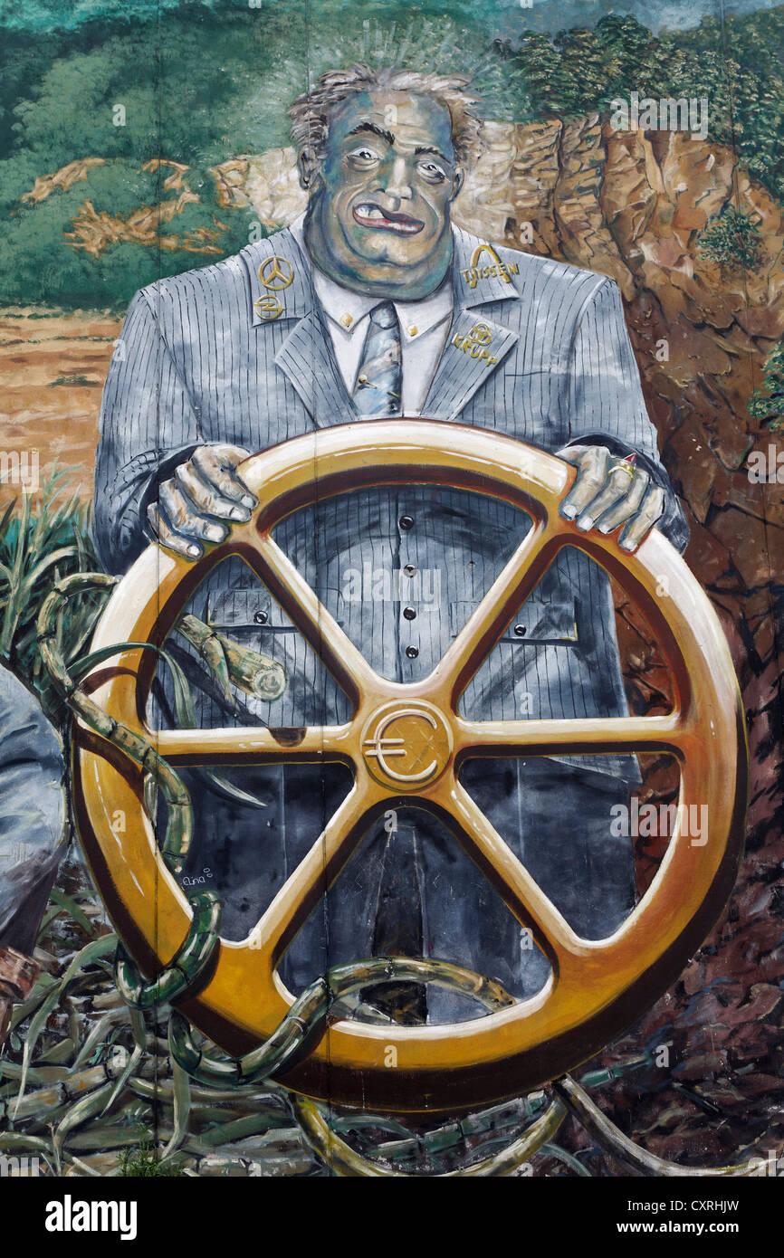 Industry captain at the steering wheel, anti-capitalist graffiti, graffiti art, street art, Bochum, Ruhr Area - Stock Image
