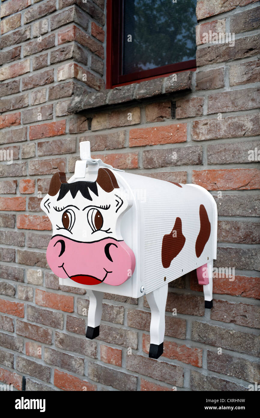 Original postbox in the shape of a cow, North Rhine-Westphalia, Germany, Europe - Stock Image