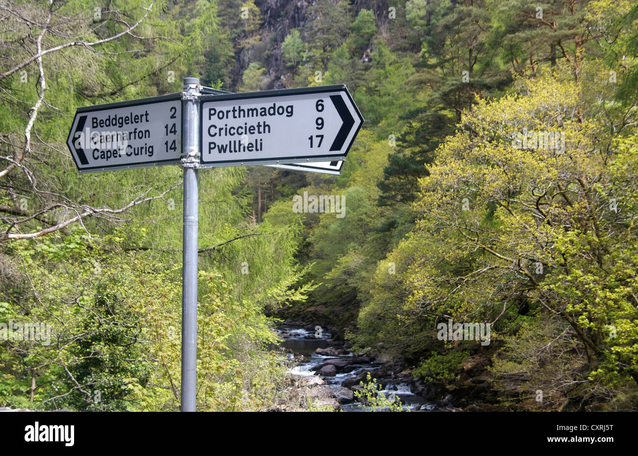 Road signpost with Welsh place names in Aberglaslyn Gorge Near Beddgelert Gwynedd North Wales UK - Stock Image