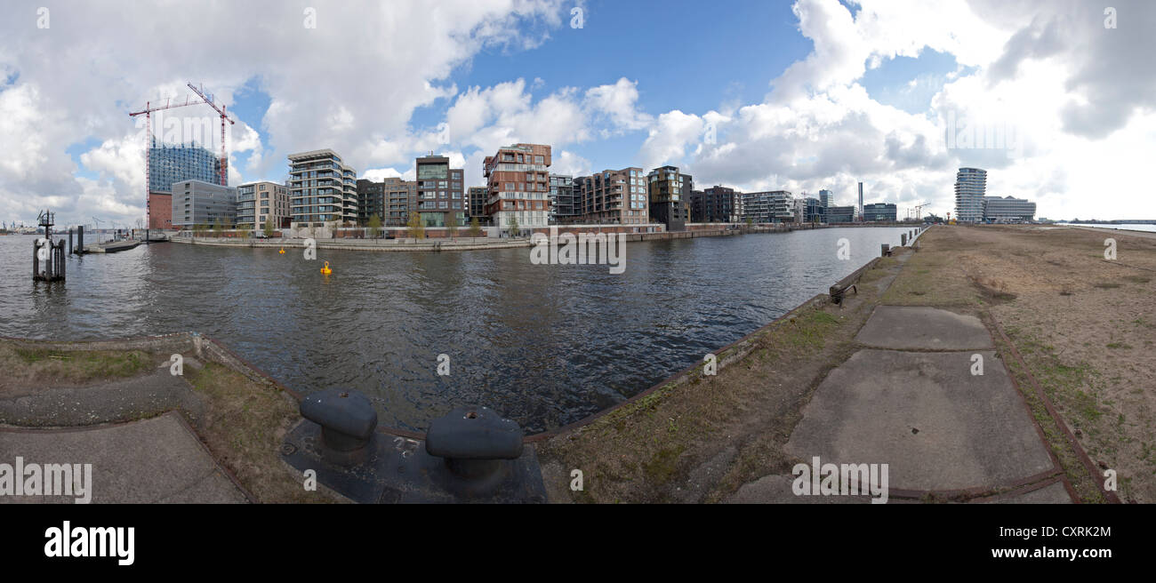 Panoramic view of a undeveloped quay on the Elbe river to Hafencity with the Elbe Philharmonic Hall under construction - Stock Image