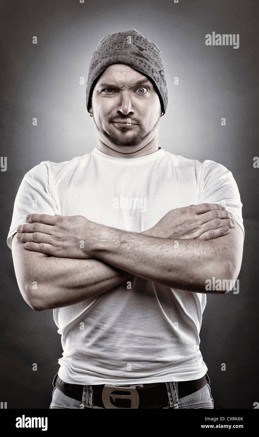 Man in a macho pose, edited portrait - Stock Image