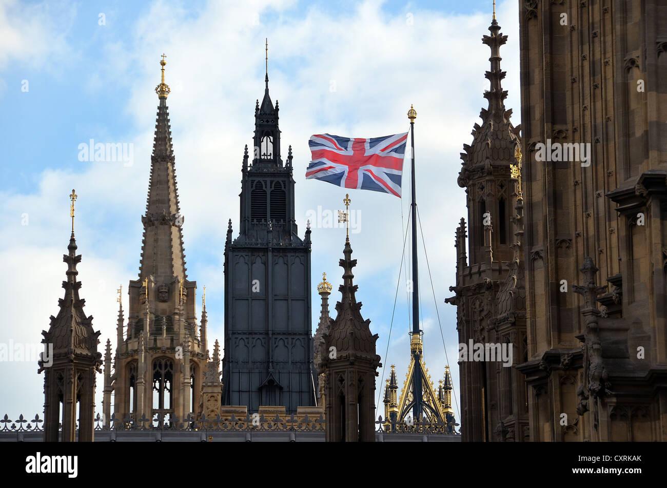 British Flag, Union Jack or Flag, flying above the Houses of Parliament, London, England, United Kingdom, Europe - Stock Image
