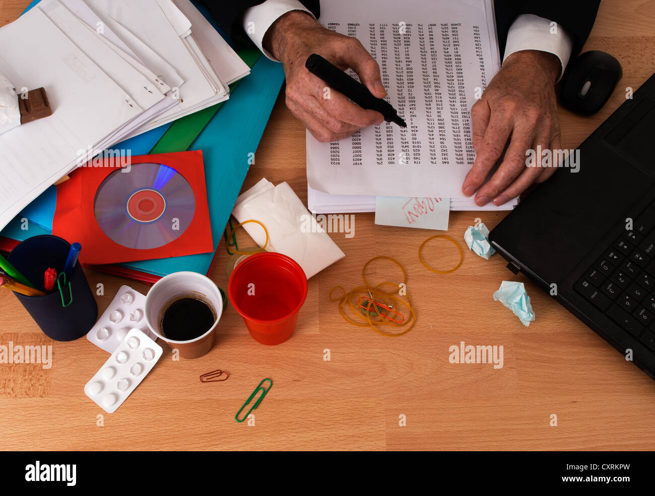 Businessman with lots of work - overwork, stress in the office - Stock Image
