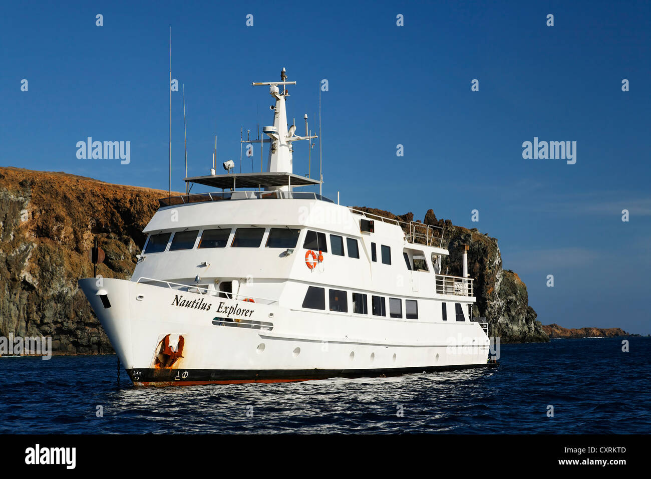 Ship, liveaboard, Indian Ocean Explorer, off the cliff coast, San Benedicto Island, near Socorro, Revillagigedo - Stock Image