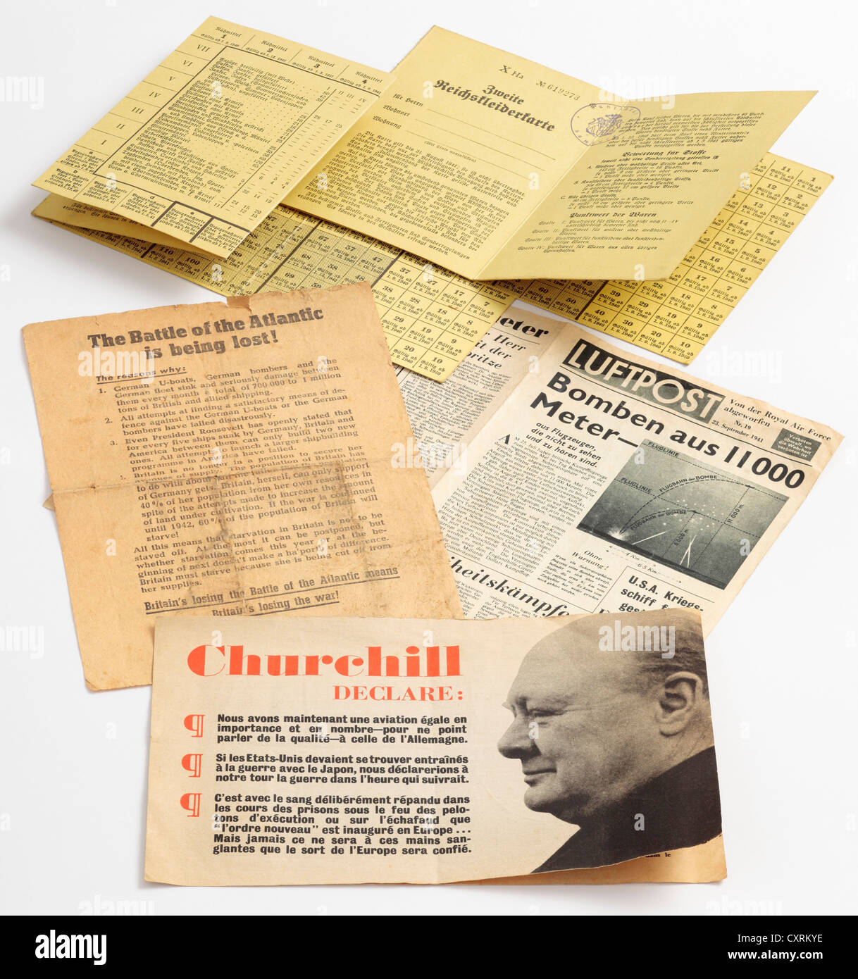 British and German Wartime Propaganda, Counterfeit Ration Books and Publicity Leaflets from WW2 dropped from the - Stock Image