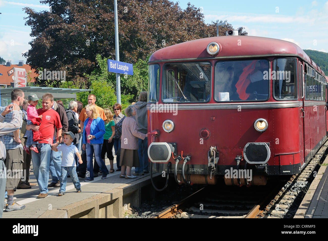 Passengers boarding the German Uerdinger railcar in the train station of Bad Laasphe, Siegen Wittgenstein district - Stock Image
